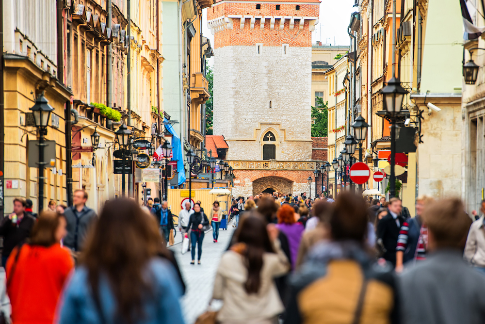 Busy tourists shopping at a street in Europe on their holiday.